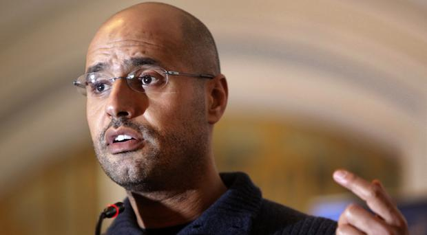 Saif al-Islam Gaddafi has been sentenced to death over killings in the 2011 uprising (AP)