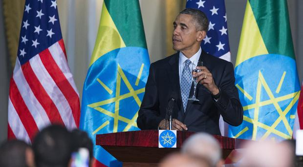 Barack Obama offers a toast during a state dinner hosted by Ethiopian prime minister Hailemariam Desalegn (AP)