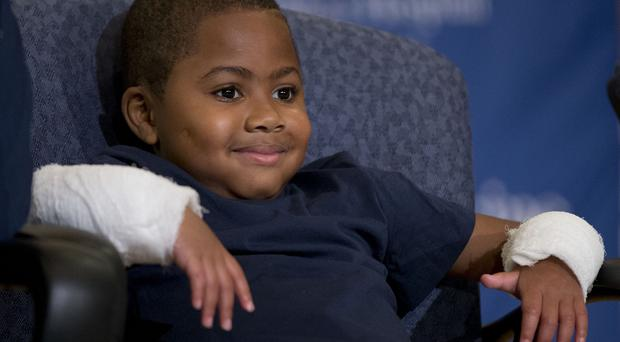 Double-hand transplant recipient eight-year-old Zion Harvey (AP)