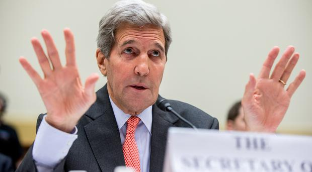 John Kerry pitches the controversial nuclear deal with Iran to the Foreign Affairs Committee (AP)