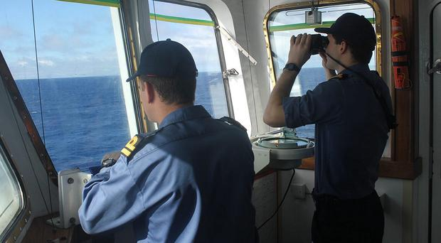 The crew of survey ship HMS Echo in the southern Indian Ocean help in the underwater search for the flight recorder from the missing Malaysia Airlines flight MH370 (MoD/PA)
