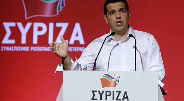Greek prime minister Alexis Tsipras addresses a meeting of his ruling radical left Syriza party's central committee in Athens (AP)