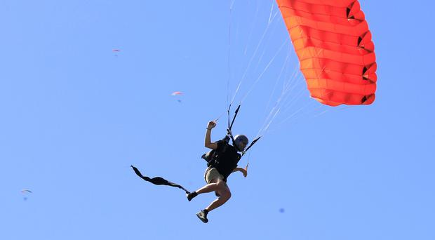 A skydiver prepares to join the world record breaking formation above Chicago