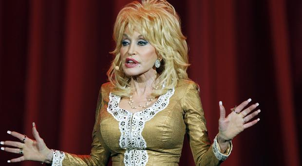 Dolly Parton is working with NBC on a TV movie of her life based on her hit song Coat Of Many Colours (Invision/AP)