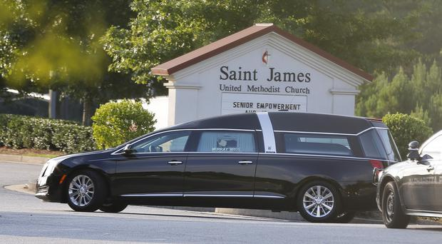 A hearse arrives at St James United Methodist Church before a funeral service for Bobbi Kristina Brown in Alpharetta, Georgia (AP)