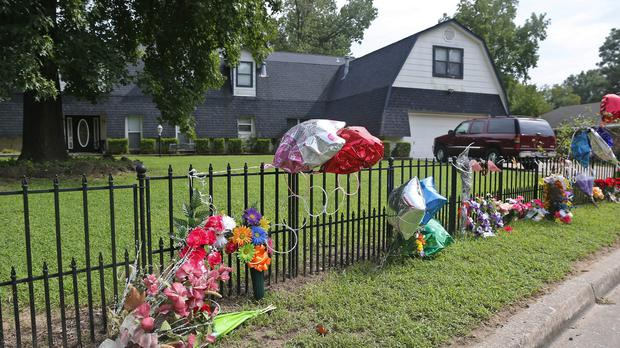 Flowers have been left at the scene of the stabbings in tribute to the family (AP)