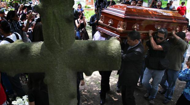 Men carry the casket of murdered photojournalist Ruben Espinosa during his funeral service in Mexico City (AP)
