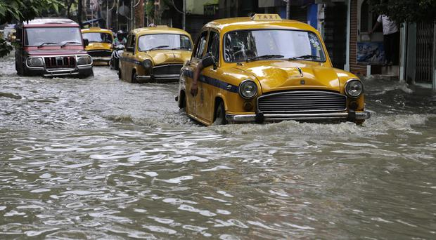 Heavy rains have caused chaos across India (AP)