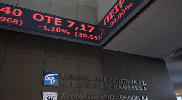 Stock prices are displayed on a ticker screen inside the Athens' Stock Exchange (AP)