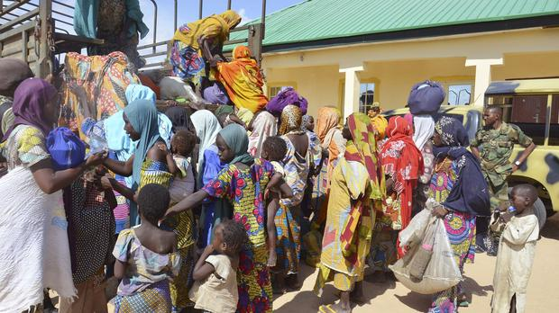 Women and children rescued by Nigerian soldiers from Boko Haram extremists in the north-east of Nigeria arrive at the military office in Maiduguri (AP)