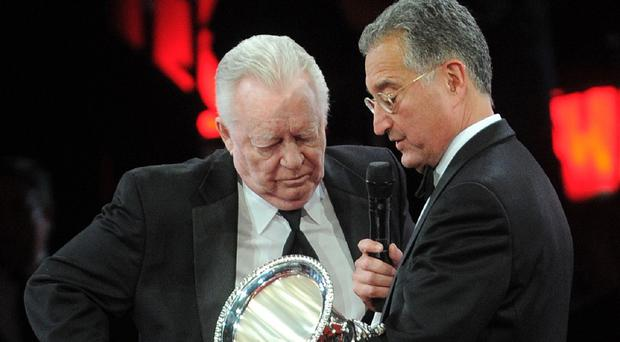 Billy Sherrill, left, receives the BMI Icon award from BMI president Del Bryant at the 2010 BMI Country Awards in Nashville (AP)