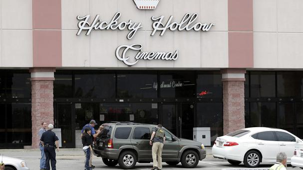 Police outside a cinema where a man was shot dead by a SWAT team (AP)