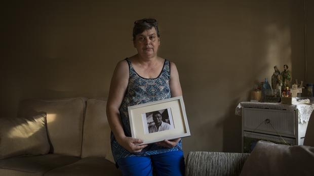 Jacquita Gomes holds a portrait of her husband Patrick, a flight attendant on the ill fated Flight MH370 (AP)