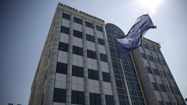 A European Union flag flutters outside the Athens Stock Exchange (AP)