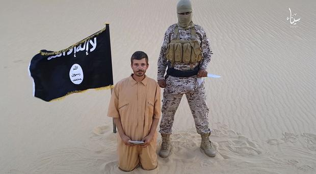 Croatian hostage Tomislav Salopek seen in a purported Islamic State video (Militant website/AP)