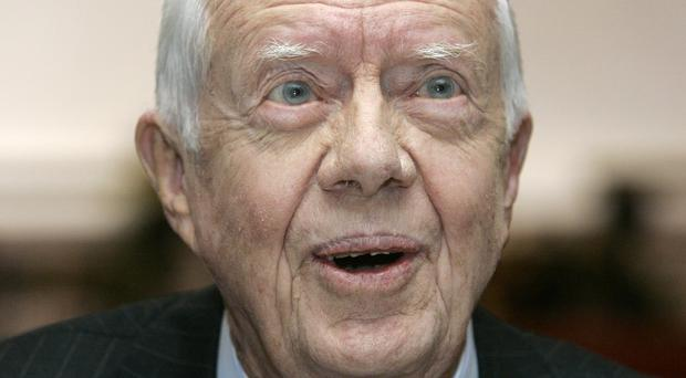 Former US president Jimmy Carter is to undergo cancer treatment at an Atlanta hospital (AP)