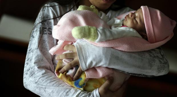 An 11-year-old girl in Paraguay has given birth to a daughter after being denied an abortion (AP)