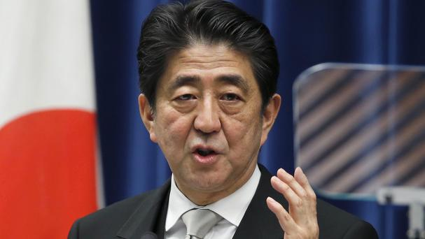 Shinzo Abe says Japan must face its history but future generations should not have to continue apologising. (AP)