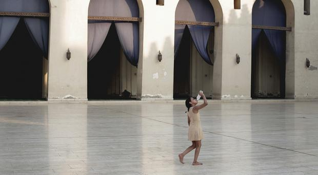 A girl cools off at the Al-Hakim bi-Amr Allah Mosque in Cairo. (AP)