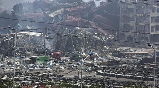 The smoking remains of the explosion in China's Tianjin port city (AP)