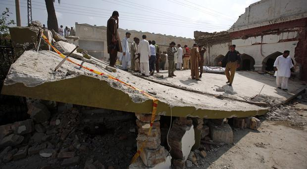 Rescue workers at the site of the suicide bombings in Shadi Khan. (AP)