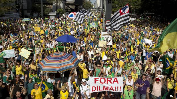 Demonstrators demand the impeachment of Brazilian President Dilma Rousseff in Sao Paulo (AP)