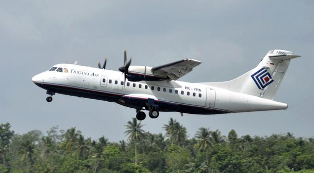 The same type of Trigana airliner seen in this photo lost contact with ground control in Indonesia while carrying 54 people (AP)