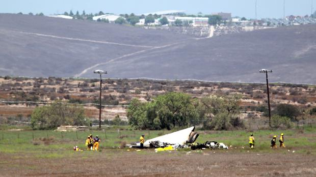 Wreckage from the crash between two planes, one leased by BAE Systems, in southern San Diego County (U-T San Diego/AP)