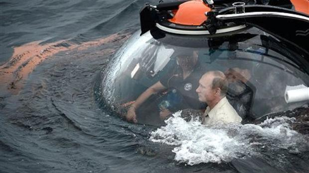 Russian president Vladimir Putin sits on board a bathyscaphe as it plunges into the Black Sea along the coast of Sevastopol, Crimea (Alexei Nikolsky/RIA-Novosti, Kremlin Pool Photo via AP))