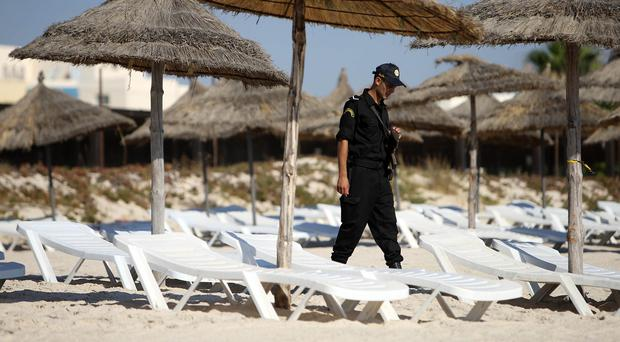 A police officers patrols the beach in Sousse