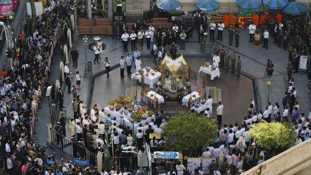 Thai officials and diplomats gather at the Erawan Shrine (AP)