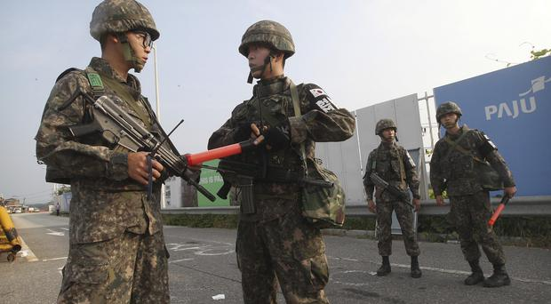 South Korean army soldiers stand guard on Unification Bridge, which leads to the demilitarised zone, near Panmunjom (AP)
