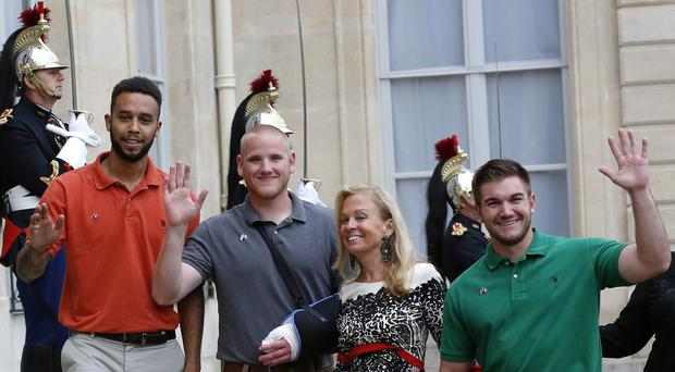 Student Anthony Sadler, US Airman Spencer Stone, US ambassador to France Jane Hartley and US National Guardsman Alek Skarlatos (AP)