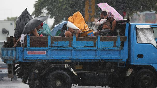 People take cover as Typhoon Goni hits Japan