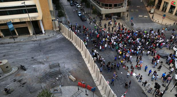 Lebanese activists protest in front a concrete wall installed by authorities, near the main Lebanese government building. (AP)