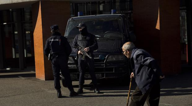 Armed police officers standing guard outside Atocha train station in Madrid. (AP)