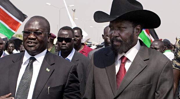 South Sudanese President Salva Kiir, right, and former vice-president Riek Machar, left, have signed a peace agreement. (AP)