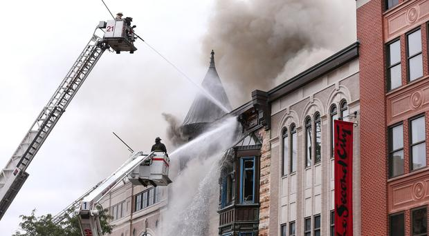 Firefighters battle a fire in a building that houses the offices of Chicago's famed Second City theatre company (Chicago Tribune/AP)