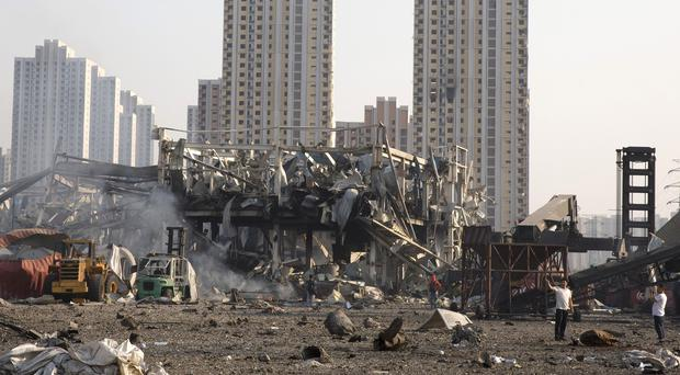 Eleven government officials and company executives have been detained over the warehouse explosion in Tianjin (AP)