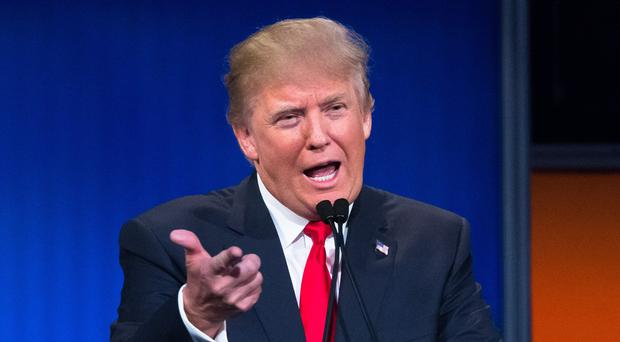 Republican presidential candidate Donald Trump says his hair is for real (AP)