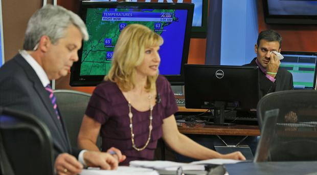 WDBJ-TV7 anchors Kimberly McBroom and guest anchor Steve Grant pay tribute to shot colleagues