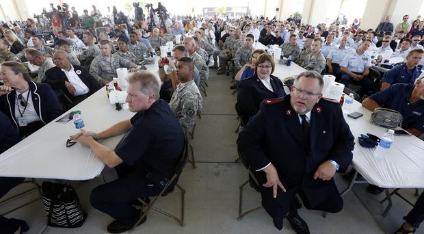A standing-room only audience of first responders to the Hurricane Katrina emergency listen to salutes from past and present state government officials (AP)