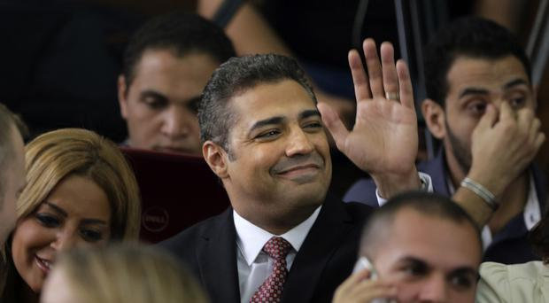 Al-Jazeera English journalist Mohammed Fahmy before his verdict in a courtroom in Tora prison in Cairo, Egypt. (AP)