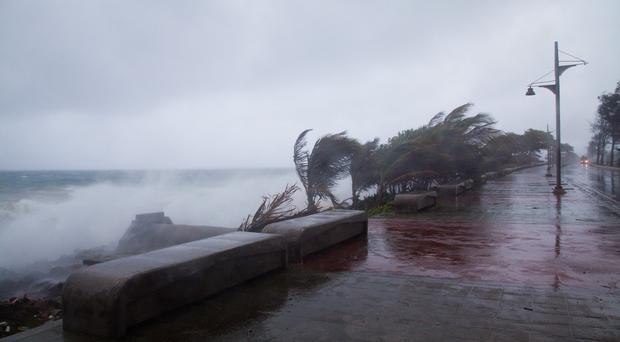Strong winds and waves batter the coast as tropical storm Erika approaches Santo Domingo, Dominican Republic (AP)