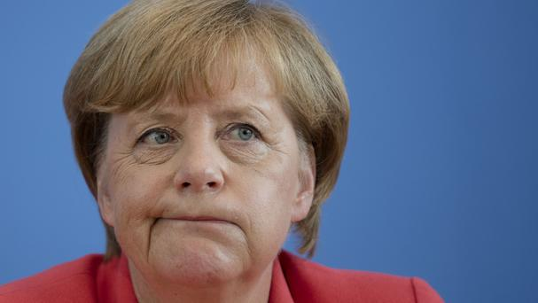 Angela Merkel says the EU's states must share the responsibility for refugees seeking asylum. (AP)