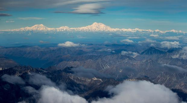 The newly-renamed Denali is seen from a window of Air Force One on approach to Anchorage, Alaska (AP)