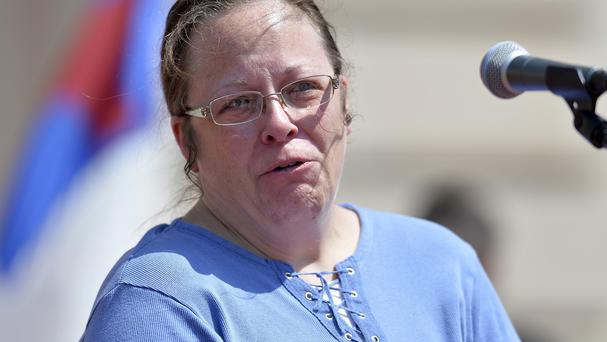Rowan County clerk Kim Davis is cheered by a gathering of supporters during a rally (AP)