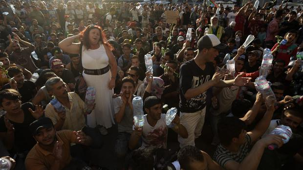 Migrants wait in front of Keleti railway station in Budapest. (AP)