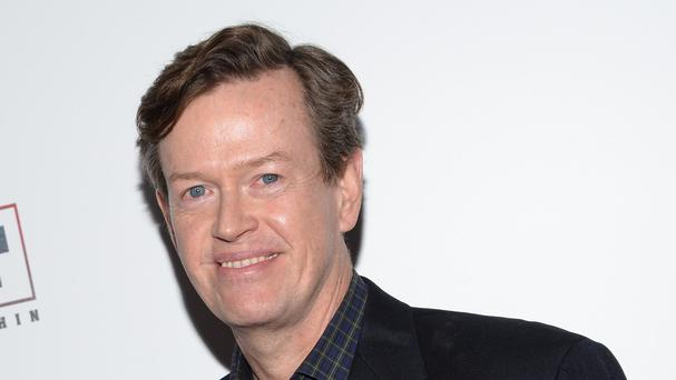 Dylan Baker tried to rescue an elderly neighbour from a fire in New York (Evan Agostini/Invision/AP)