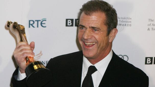A photographer complained to police about the August 23 altercation with Mel Gibson